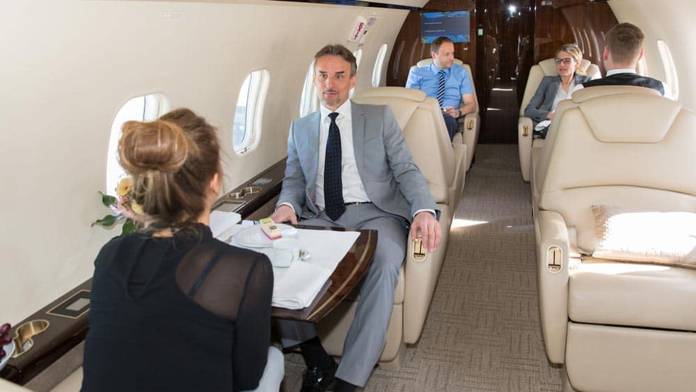 Business people on a jet