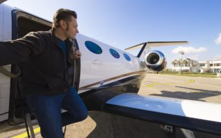 Superstar embarking from private jet