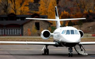 Private Jet with Fall Leaves in Background