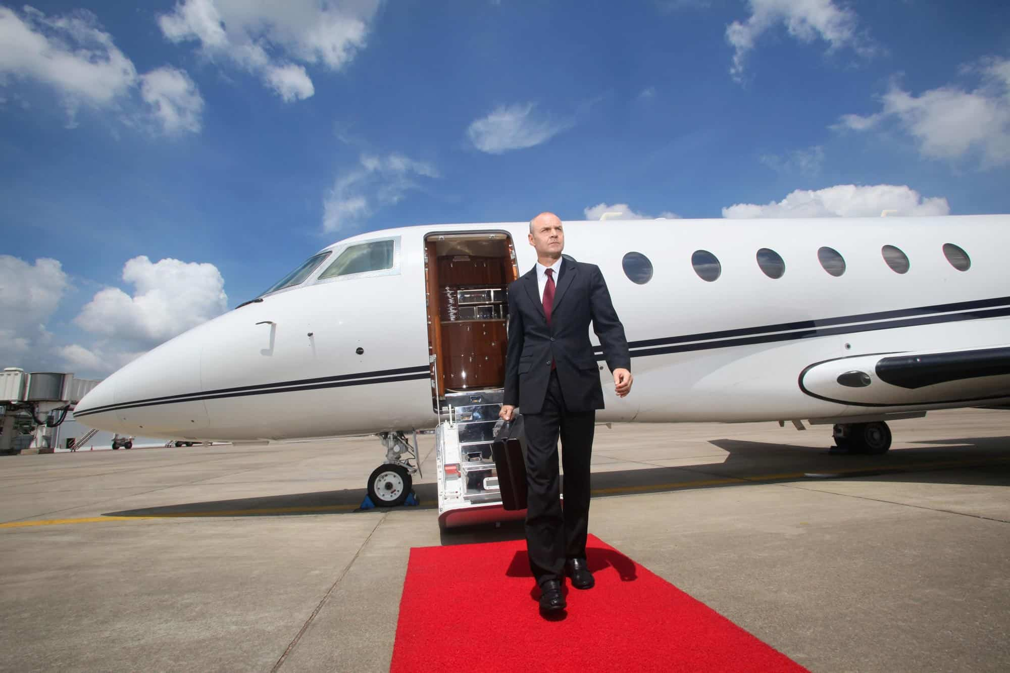 Business Executive walking from a Private Jet