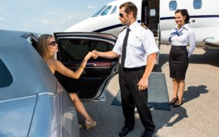Lady being escorted out of limo by the pilot to board a private jet