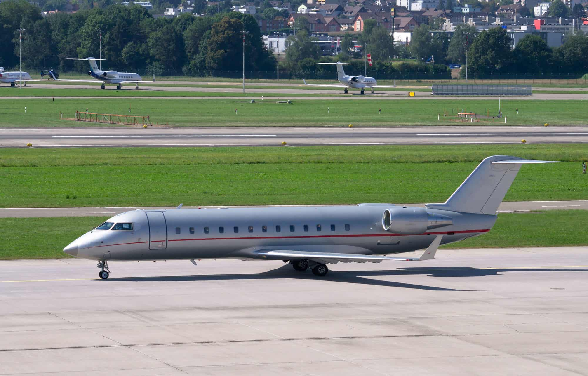 Private Jet at an Airport - Brokers can help you choose airports closest to your destination