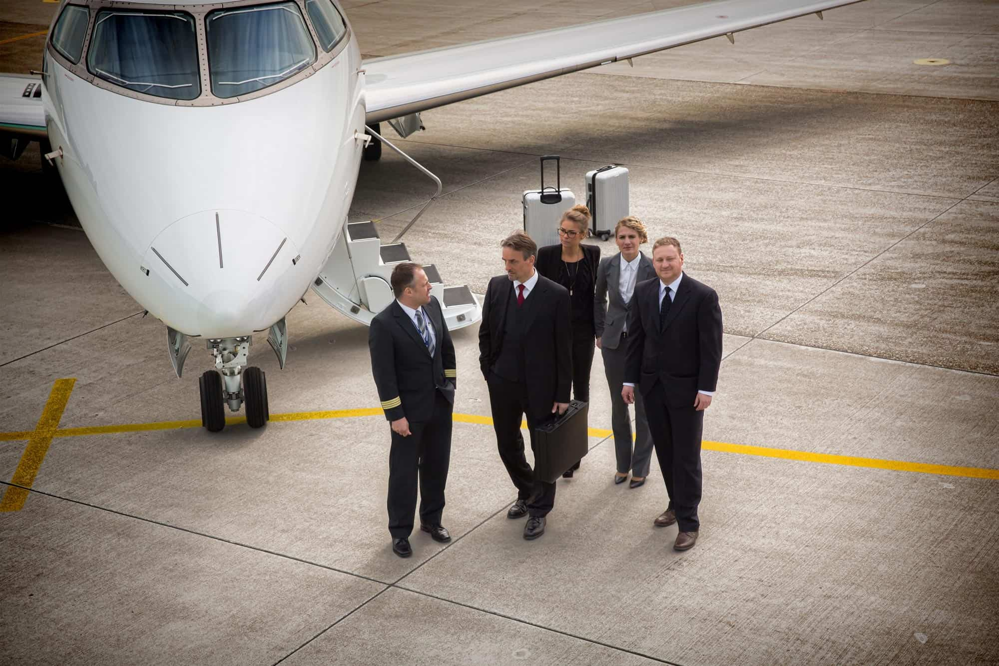 Small Business Executives next to Private Jet
