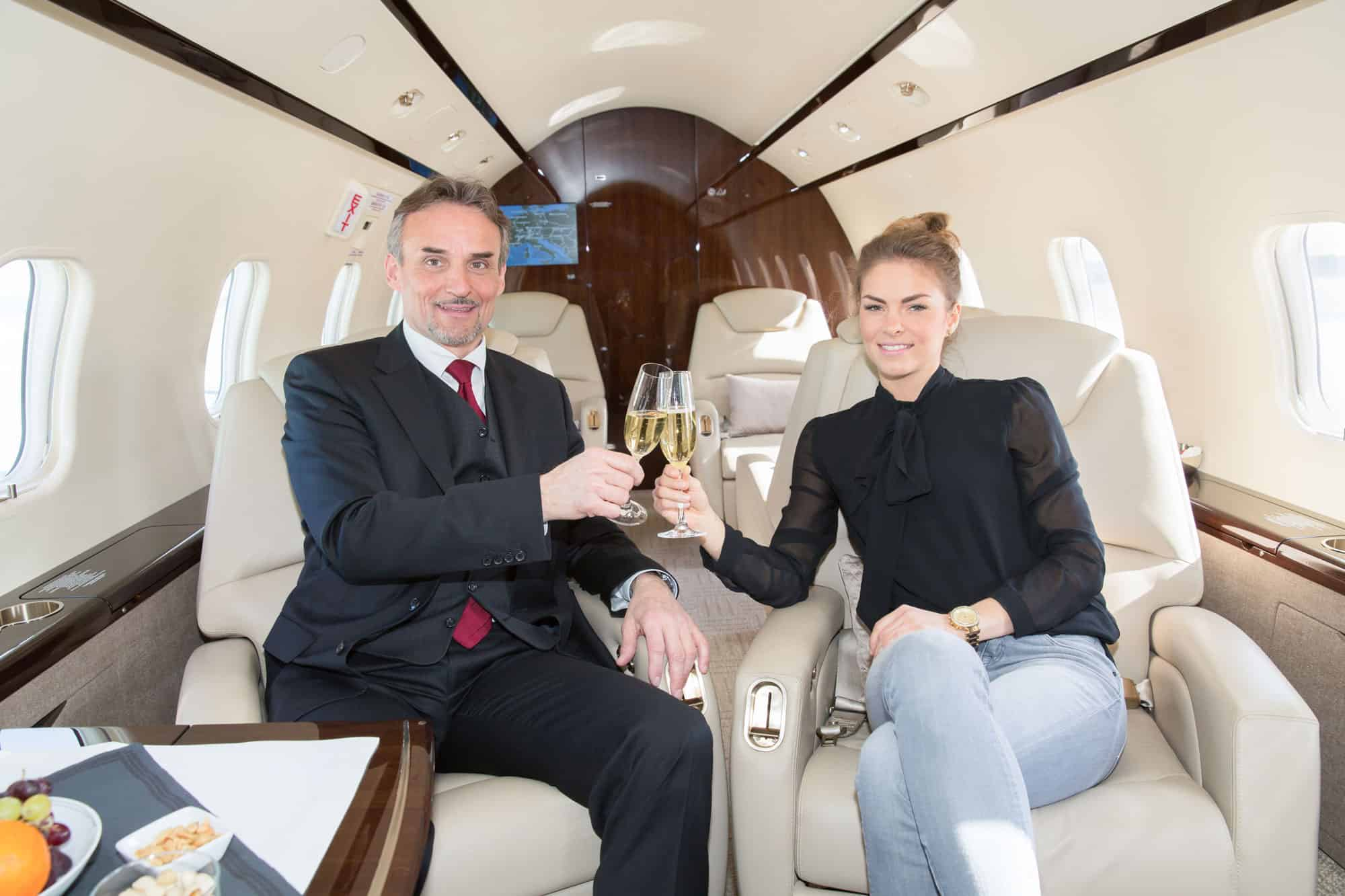 A champagne toast on a private jet - alcohol etiquette on private jets