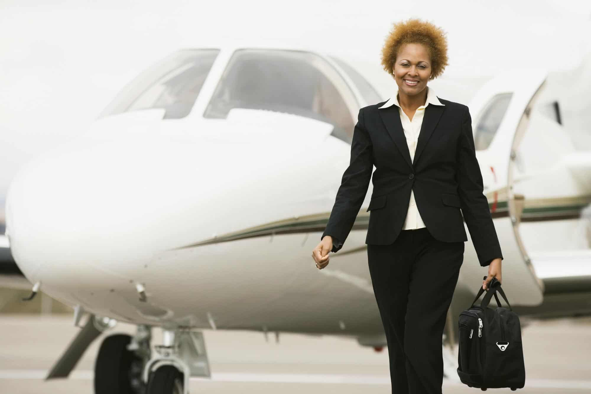 Lady next to private jet