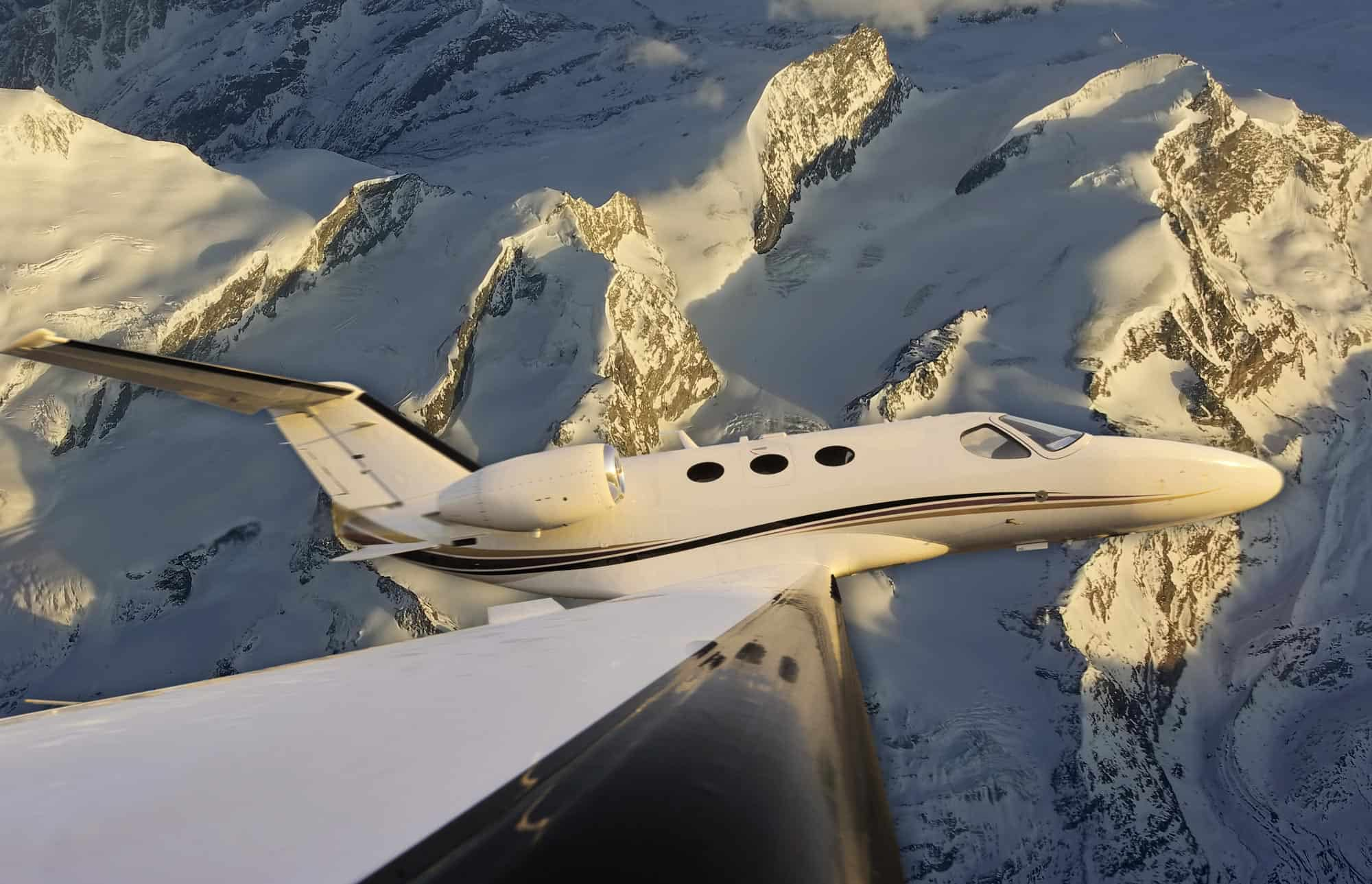 Private Jet over the Mountains in the Winter