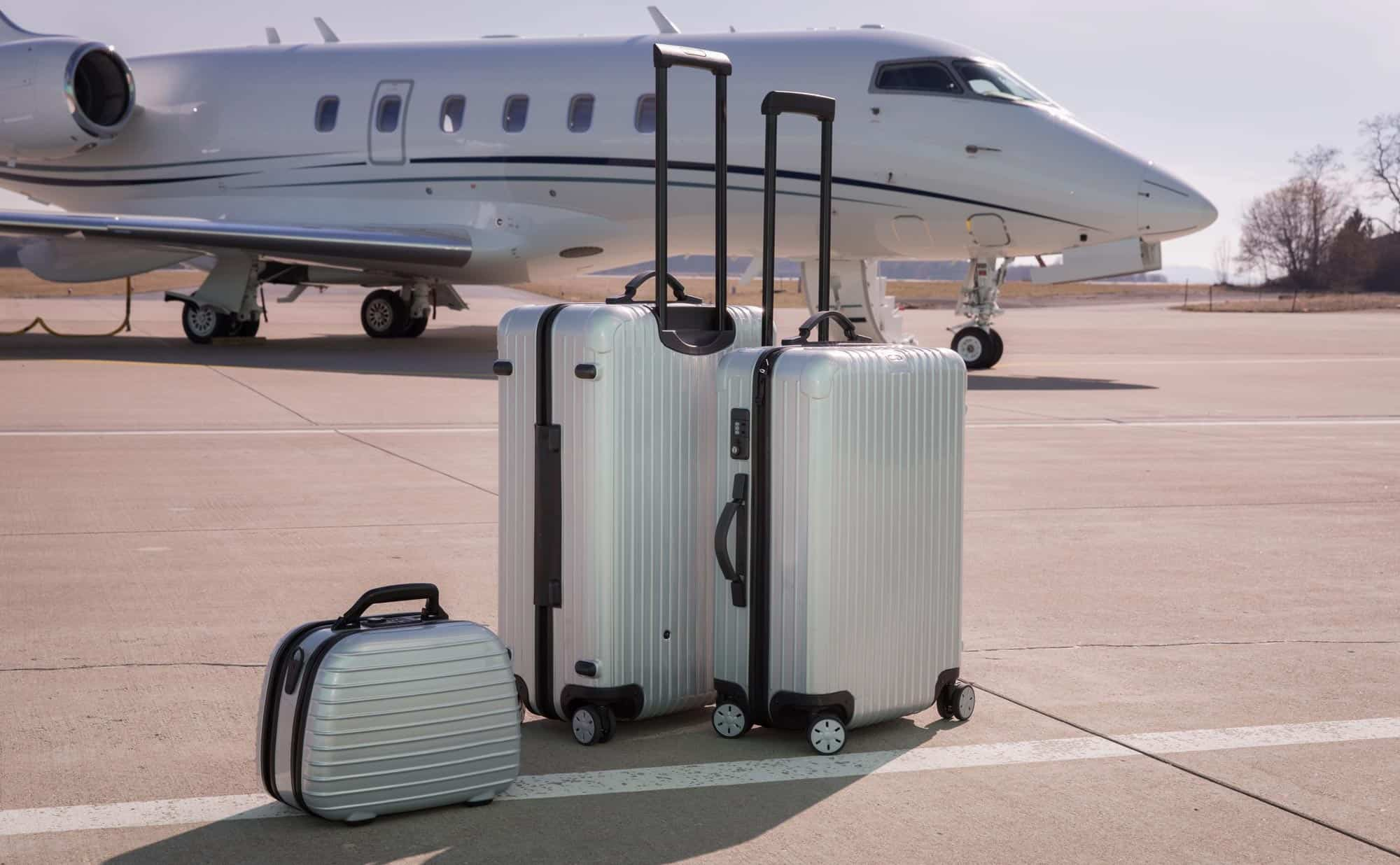 Luggage next to private jet