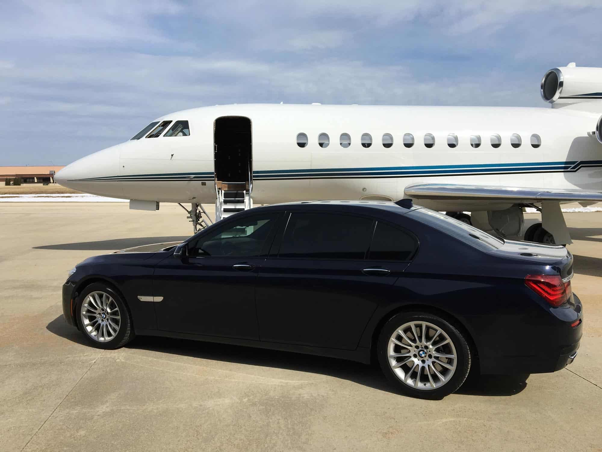 Car Next to Private Jet