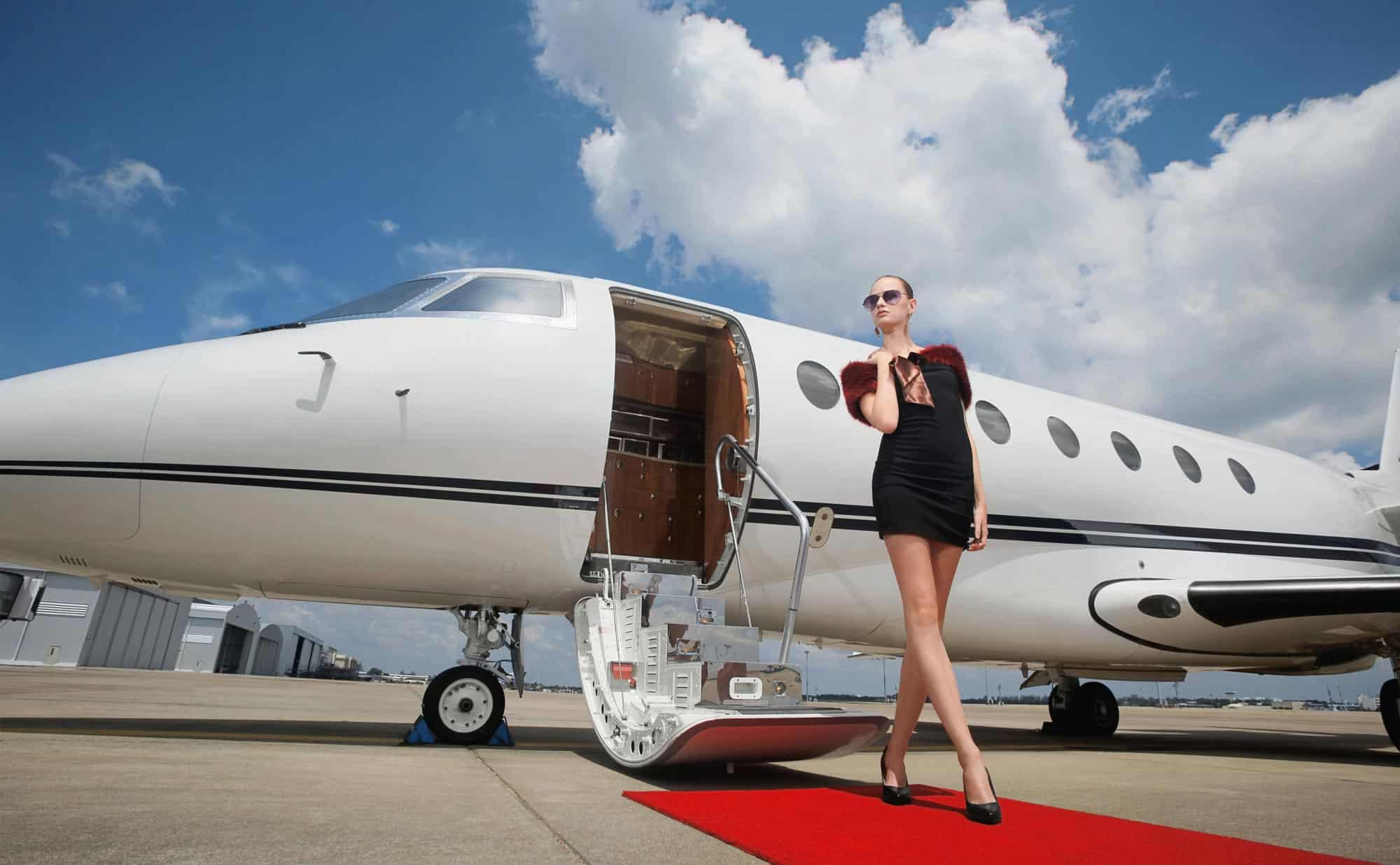 Celebrity walking from private jet
