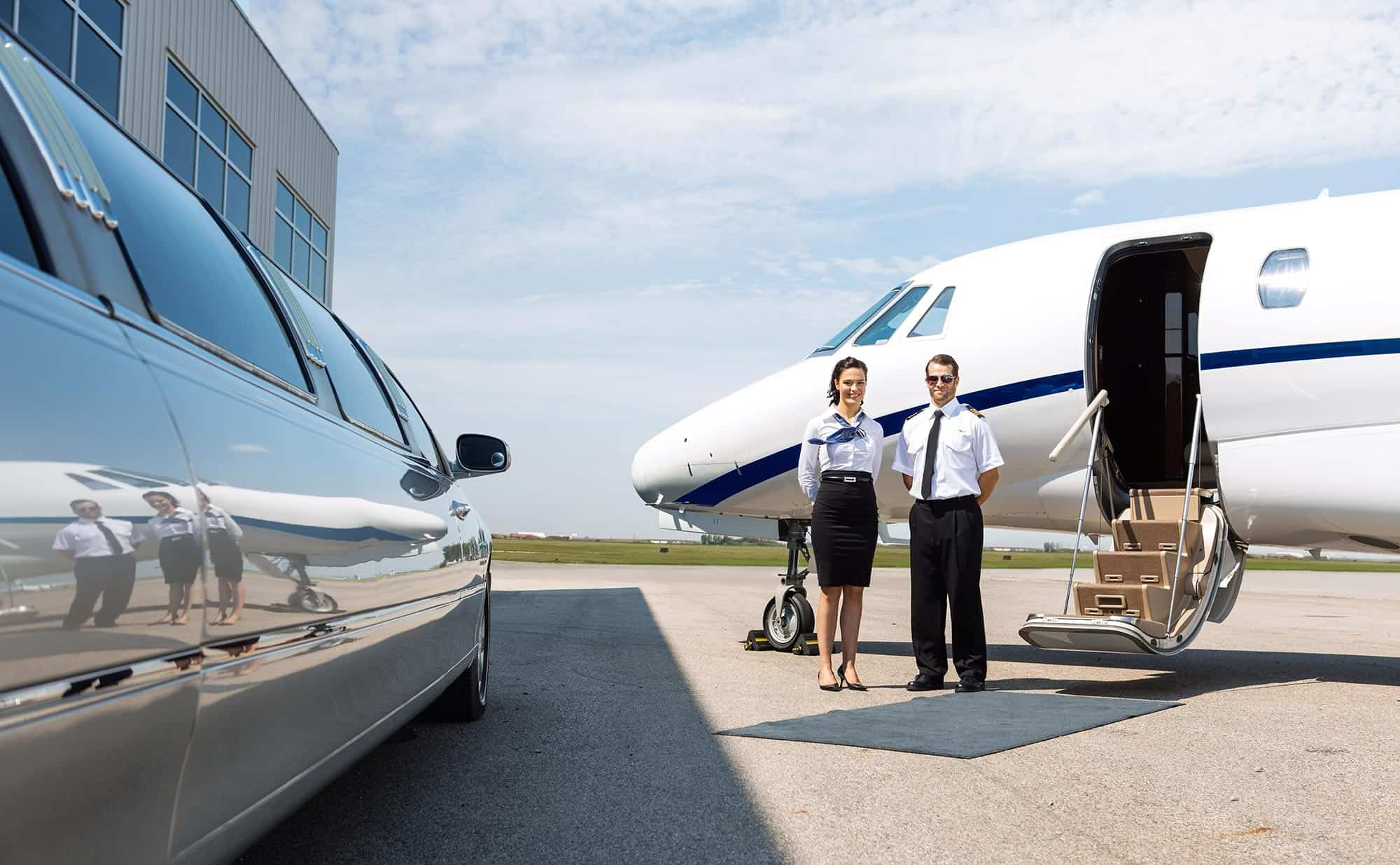 Crew welcoming private jet flyers