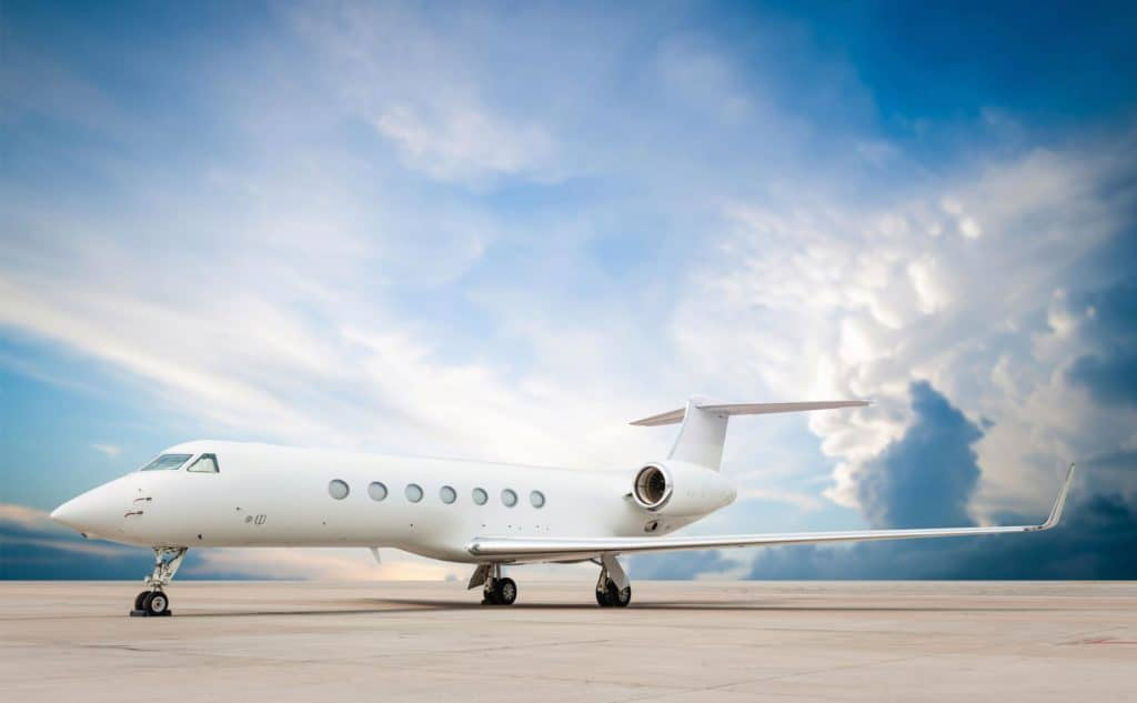 Gulfstream Jet on Tarmac against Blue Sky