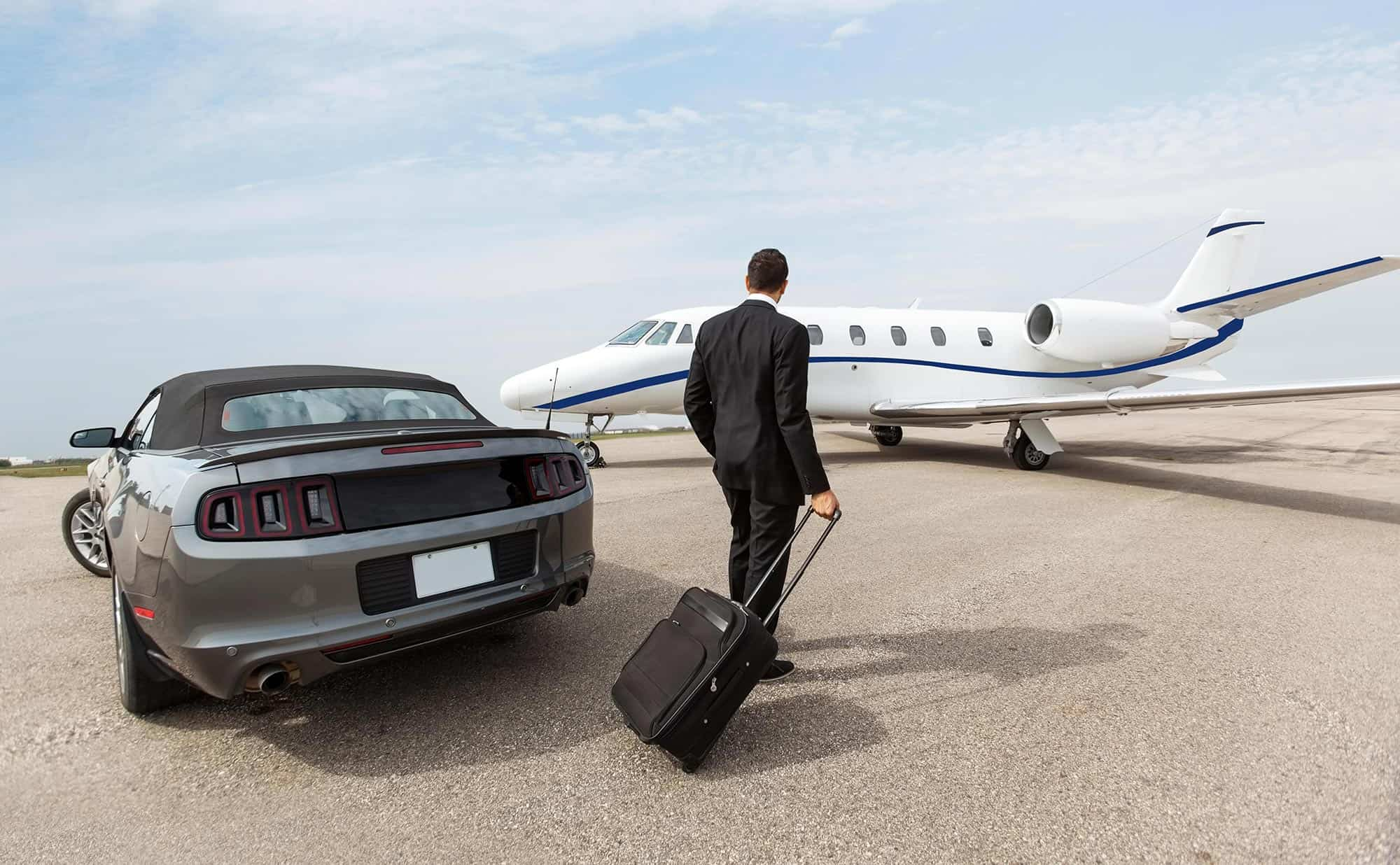 Man approaching private jet with luggage