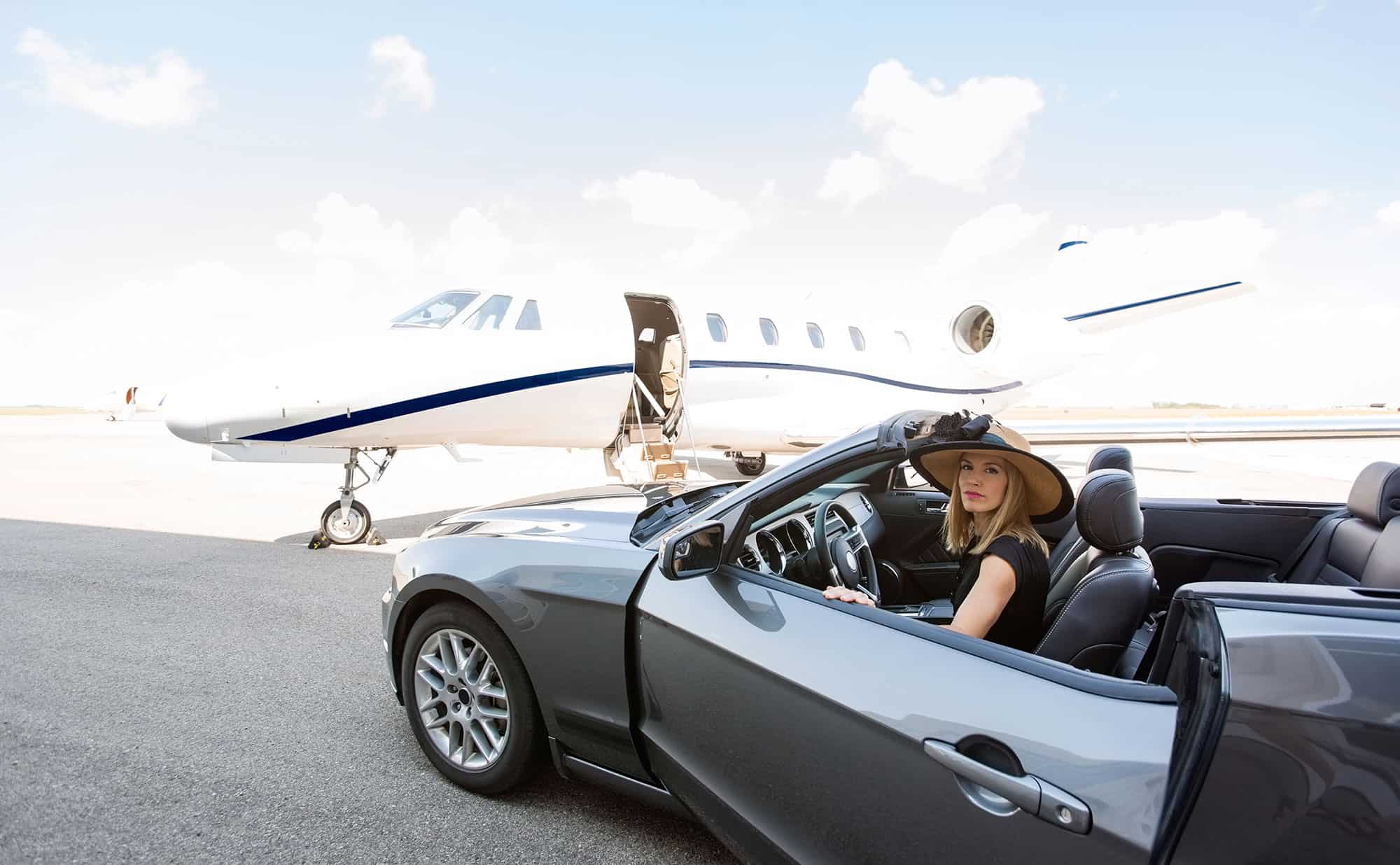 Passenger arriving in car to board jet via ramp access