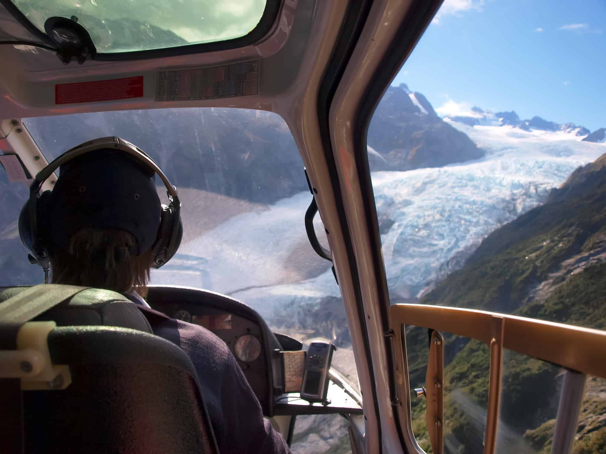 a helicopter pilot flying a helicopter