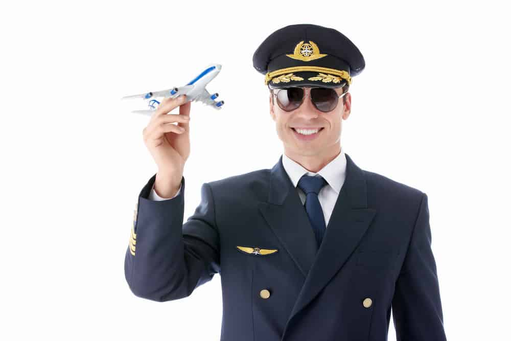 pilot holding a model airplane