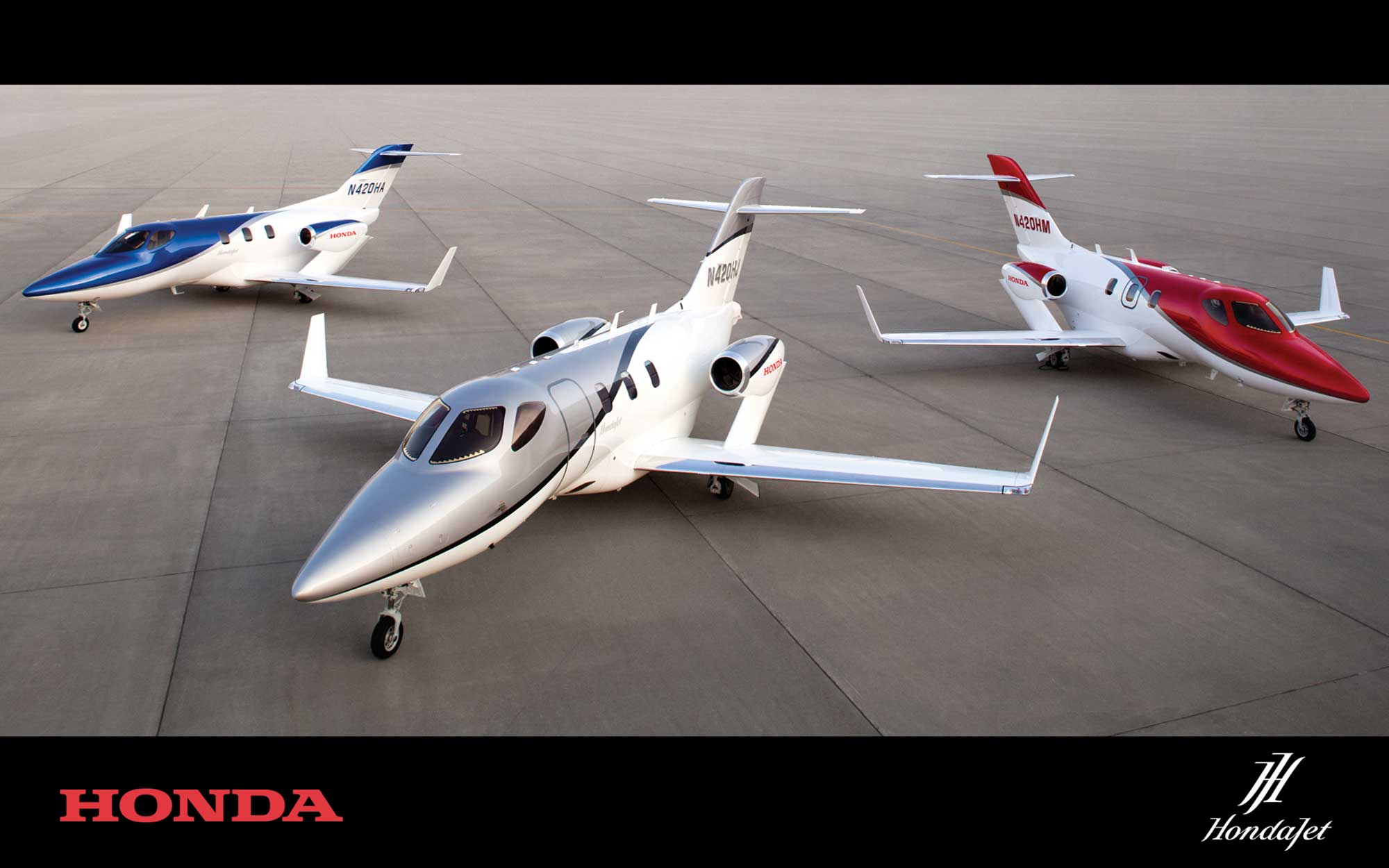 three Honda Jets stalled outside on a landing course