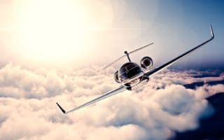 A private jet flying through the sky